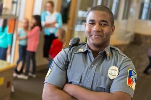 Friendly school security guard working on elementary school campus